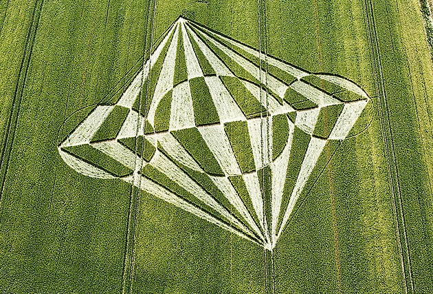 a description of the crop circles which has been found throughout the whole country Crop circles are shapes that are found in grain-related crops, in which the vegetation is bent into angles and then spiraled into complex patterns (andrews 37) crop circles have been around since the ancient times, but have only started to appear in numbers since the mid-1960's.